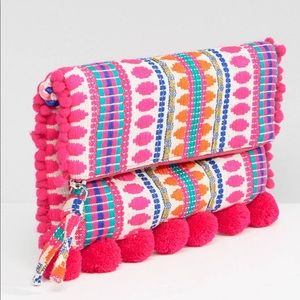 Fold over woven cross body bag with pom poms